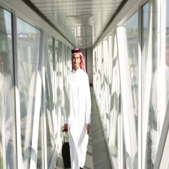 Arab man walking with luggage at airport. Stock Footage