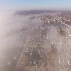 Foggy Town Flyover Stock Footage