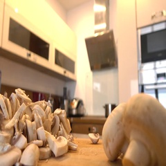 Man slicing field mushrooms in the kitchen Stock Footage