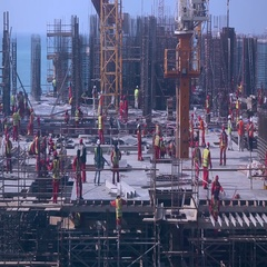 Workers on construction site at Jumeirah Beach Residence, Dubai, UAE. Stock Footage