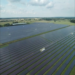 Aerial of solar panels at solar power plant Stock Footage