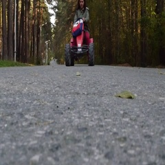 Girl rides on asphalt Stock Footage