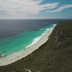 Aerial of beautiful turquoise sea and beach along the coastline Stock Footage