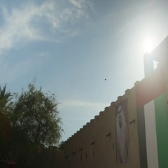 UAE National Day Flag and Sheik's poster on traditional Arab building in Al Stock Footage