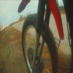 Racer to Enduro rides on off-road Stock Footage