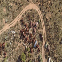 Aerial of automobile scrapyard in the desert Stock Footage