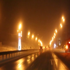 Driving on the road at night in snowy weather Stock Footage