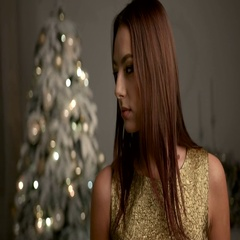 Beautiful young woman wearing gold dress , posing on camera, while staying near Stock Footage