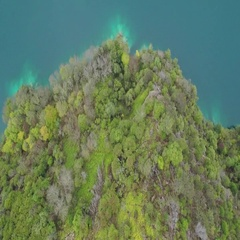 Aerial of beautiful turquoise sea and green cliff Stock Footage