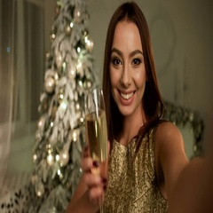 Young smiling woman wearing gold dress, taking selfies on her phone Stock Footage