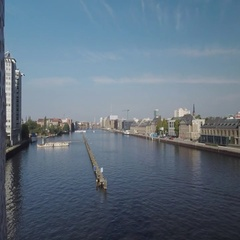 Aerial of Molecule Man sculpture, Berlin cityscape and pier in Spree river Stock Footage