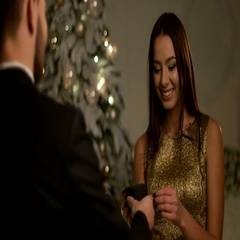 Happy young man making proposal for his beautiful girlfriend on New Year day Stock Footage