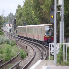 Train moving on railway track in Berlin city Stock Footage