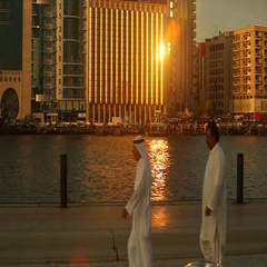 Emirati men walking at Dubai Creek, Dubai, United Arab Emirates. Stock Footage