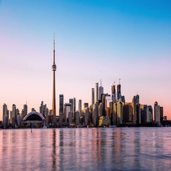 Toronto skyline with CN Tower & Rogers Centre time lapse Stock Footage