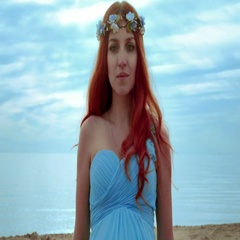 Red hair woman portrait on sea coast. Closeup of redhead woman Stock Footage