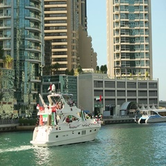Yacht decorated with flags and balloons for UAE National Day Celebration, Dubai Stock Footage