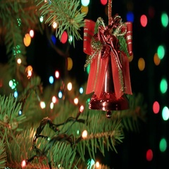Christmas bell on Christmas tree with blurred lights garlands, fairy background Stock Footage