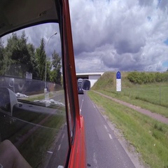 Car passing through the bridge while moving on the country road Stock Footage