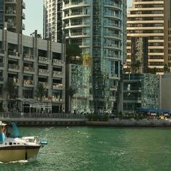 Speed boat sailing at Dubai Marina, Dubai, United Arab Emirates. Stock Footage