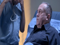Doctor checks on mature male patient in hospital bed in evening 4K Stock Footage