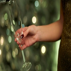 Woman in gold dress holding a glass of champagne sparkle on New Year Eve Stock Footage