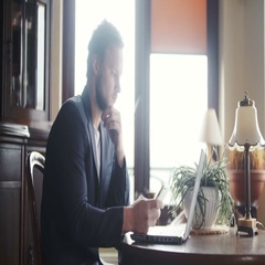 Man works from home using laptop Stock Footage