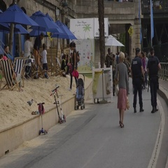 Soldiers and security police patrol Paris Plage beach in France Stock Footage