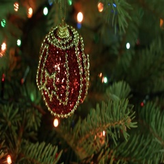 Magically decorated Christmas Tree with balls, ribbons and garlands on a blurred Stock Footage