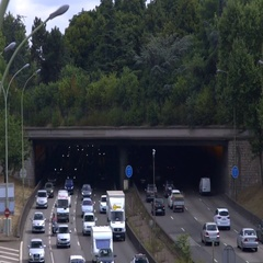 Multi-lane highway tunnel with forest atop - traffic time lapse Stock Footage