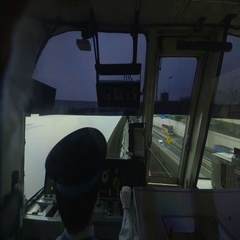 Tokyo Monorail driver at controls, normal speed Stock Footage