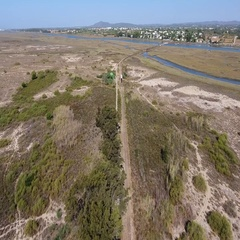 Aerial. Railroad across the Ria Formosa to the beach Barril. Stock Footage