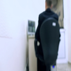 Blurred security guard at surveillance monitor Stock Footage