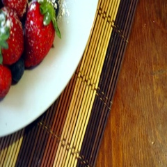 Fresh berries and croissants on the wooden table Stock Footage
