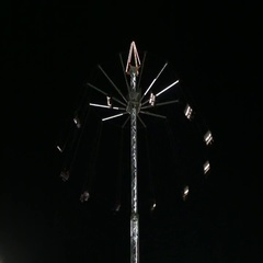 Illuminated fairground wheel at Global Village, Dubai , United Arab Emirates. Stock Footage