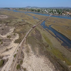 Aerial . Railroad to the sky, through the Ria Formosa to the beach Barril. Stock Footage