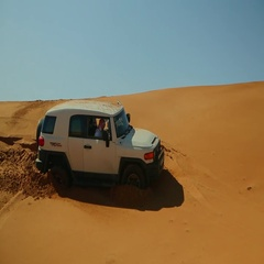 Arab men getting out of the bogged 4x4 on desert. Stock Footage