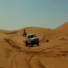 Car drifting and quad biking on desert. Stock Footage