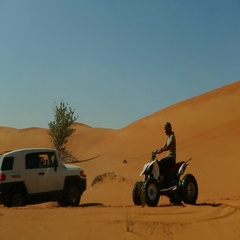 Car drifting and quad biking on desert. Stock Footage