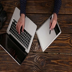 Top view of tablet and laptop with retoucher Stock Footage