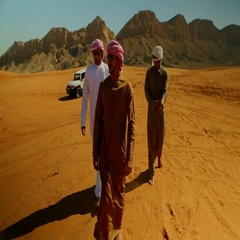 Emirati men walking together on desert. Stock Footage