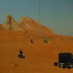Friends quad biking on desert. Stock Footage