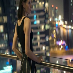 Young, happy woman admire cityscape view on terrace at night Stock Footage