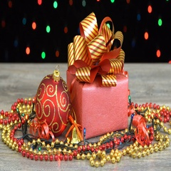 Beautiful Christmas gift box with red and golden striped bow and decorations on Stock Footage