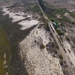 The rails for a train from the sky, through the Ria Formosa to the beach Barry. Stock Footage
