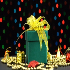 Beautiful Christmas green gift box with golden bow and decorations rotating Stock Footage