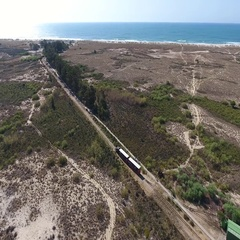 Aerial. Train goes through the Ria Formosa to the beach Barry. Stock Footage