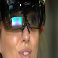 A young woman having fun testing the augmented reality glasses. Stock Footage