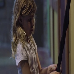 Little Girl Practices Braiding Technique On Rope, She Concentrates Hard Stock Footage