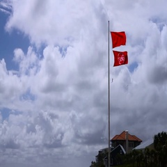 Medium shot of a double red flag on the Florida Gulf coast - Beach Closed. Stock Footage